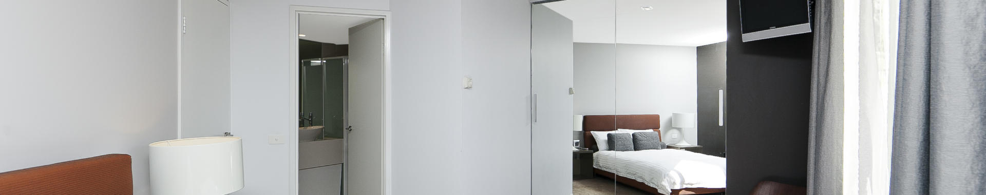Canberra Tench 2 bed corporate apartment bedroom