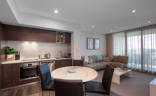 Perth Murray West 1 bed corporate apartment dining lounge